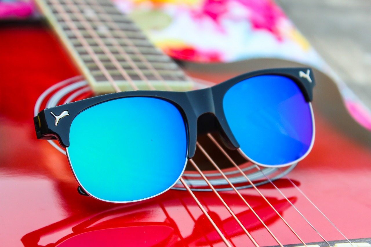 2730ca805a6 Fancy puma style blue glass with black and golden round sunglass